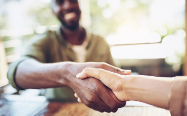 Two people shaking hands; find a lender today, get a business or commercial loan