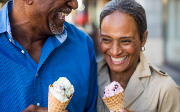 A mature couple with ice cream